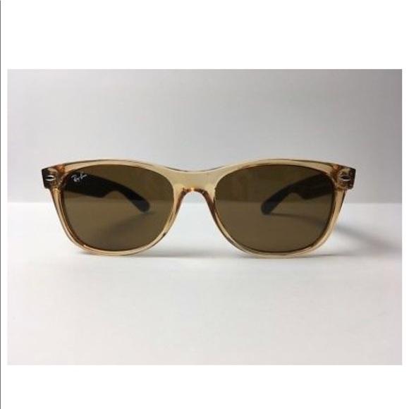33d7d56da4 Ray-Ban Wayfarer RB2132 945 Sunglasses. M 5b06ef4e9a9455373c03f19c